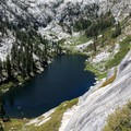 A view of Alpine Lake from a surrounding mountain.- 30 Alpine Lakes You Should Visit This Summer