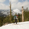 Skinning up to Signal Peak ridge with Cisco Bute in the backround.- Ski Guide to Lake Tahoe's Backcountry