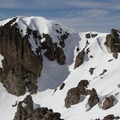 The steep sections of Castle Peak viewed here are great for advanced backcountry skiers and confident mountaineers. - 5 Reasons to Visit Truckee in the Winter