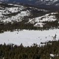 Round Valley seen from Castle Peak. The Peter Grubb Ski Hut sits on the southern edge of Round Valley just inside the trees (left in the picture).- Destination Lake Tahoe: Where Incredible Backcountry Snow Adventures Await