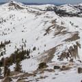 Nearing Castle Peak's summit with the Castle Peak-Basin Peak ridgeline behind.- The Ultimate Ski Guide to Tahoe's Backcountry