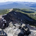 Looking down over the east ridge of Mount Thielsen (Crater Lake in the distance).- Mount Thielsen