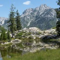 Beautiful reflections off one of the Boulder Creek Lakes.- Hiking in the Trinity Alps