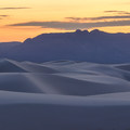 A close up of the beautiful lines created by the dunes in White Sands National Monument. The San Andreas Mountains reside in the distance.- National Park System