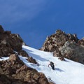 Bootpacking around rocky outcroppings up the south facing ridgeline of Dunerberg Peak.- Backcountry Skiing in California