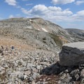 An enormous smooth rock overlooking Lookout Cabin is the perfect place to take a break and enjoy a snack.- Medicine Bow Peak Loop