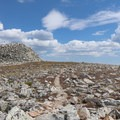 One of the oddest summits around. A flat area of vegetation followed by a mound of enormous mound of boulders that need scrambled to reach the summit.- Medicine Bow Peak Loop