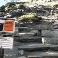 Warning signs when you begin your ascent from the woods up to the base of Half Dome.- Half Dome via Mist Trail
