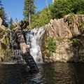 Climb the log to access jumping locations at Hatchet Falls, California.- Plunge Into Swimming Holes