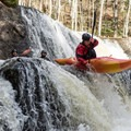 A paddler boofs the ledge just below Moonshine.- Whitewater Paddling The Northeast Classics