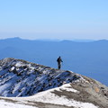 A climber along the Mount St. Helens crater rim.- Climb a Mountain