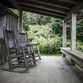 Rocking chairs on a guest cabin. You'll find rocking chairs to relax in on the office and dining hall decks as well. Sit back, and soak up life on LeConte. - LeConte Lodge