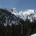 First open views of Hemlock (5,604 ft), Bryant (5,801 ft), and Chair (6,238 ft) peaks from the Source Lake Trail.- Amazing Snowshoe Trails in Washington