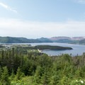 Near the long range traverse: The twin towns of Norris Point, left, and Bonne Bay, with the Tablelands in the distance.- Dramatic Fjord Formations