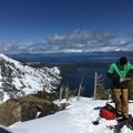 Standing on the summit of Angora Peak with Fallen Leaf Lake and Lake Tahoe in the background.- Ski Guide to Lake Tahoe's Backcountry