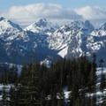 Views from Amabilis Mountain to the north of Hibox Mountain (6,547 ft), Chikamin Ridge, and Three Queens (6,687 ft).- Winter Retreat at Snoqualmie Pass