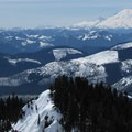 Summit view from Mount Margaret toward Mount Rainier (14,411 ft) and Mountain Adams (12,280 ft) to the south.- Winter Retreat at Snoqualmie Pass