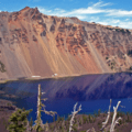 The incredible colors and contrasts of Crater Lake come alive from the summit of Wizard Island.- 100 Incredible Adventures in Our National Parks