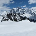 A skier crossing open slopes in front of Mount Shuksan (9,131 ft).- A Guide to Adventuring on Mount Baker