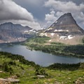 Bearhat Mountain towering over Hidden Lake.- Glacier National Park