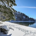 From the Donner Memorial State Park trails, you can reach the edge of Donner Lake. Note the views of Donner Peak in the background.- 5 Reasons to Visit Truckee in the Winter
