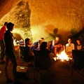 Campfires illuminate the adjacent boulders with a fiery glow at night.- Adventure Outside of Your State