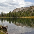 Ripples and reflections in the still waters of Washington Lake.- 70 Breathtaking Backcountry Campsites