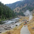 A paved path along the highway leads to the river's edge where the hot water mixes in at Sunbeam Hot Springs.- Winter Retreat to Stanley, Idaho