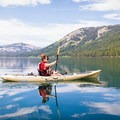Kayaking on the still waters Independence Lake.- Essentials for a Day of River Floating