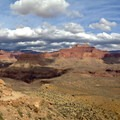 The north-facing view across the Tonto Plateau. Zoroaster Temple, Sumner Butte, and Buddha Temple are all prominent.- Grand Canyon National Park