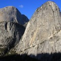 The glacial-carved granite domes of Half Dome, Mount Broderick and Liberty Cap as seen form the John Muir Trail.- National Park System