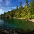 The clear waters of the north beach area in San Juan County Day Park.- San Juan Islands