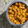 Zero-waste curry roasted chickpeas in a reusable container.- A Guide to Zero-Waste Camping