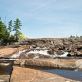 Looking at the lower cascade of Agers Falls.- 12 New York Lakes Perfect for Summer Adventure