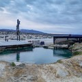 The middle pool at Spencer Hot Springs with the wooden deck and fenced-off source nearby.- Hot Springing Across Nevada