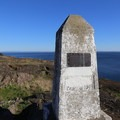 Iceberg Point reference mark from the Treaty of 1908.- Lopez Island: Iceberg Point