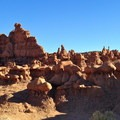 Erosion resistant rock sits atop softer layers, resulting in shapes that resemble torsos and heads at Utah's Goblin Valley State Park.- An Ode to Dr. Seuss