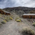 Ashford Mine Camp cabins.- Ghost Towns of the West