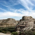 Hoodoos rise above the vegetation in Dinosaur Provincial Park.- The Essential Alberta Road Trip