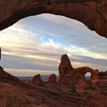 Westward view out of the North Window at daybreak.- Arches National Park