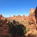 Double O Arch viewed from the west on Devil's Garden Primitive Trail.- Utah's Five National Parks