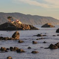Battery Point Lighthouse in Crescent City is backed by the rugged coastal cliffs of Redwood National and State Parks. - Exploring California's 9 National Parks