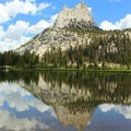 Cathedral Peak reflecting on Upper Cathedral Lake.- California's 60 Best Day Hikes