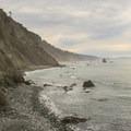 Redwood topped cliffs line the Del Norte Coast Redwoods State Park coastline.- Exploring California's 9 National Parks