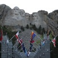 Mount Rushmore towering over the Avenue of Flags.- 5 Great American Summer Road Trips