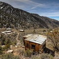 Overlooking mining buildings of Panamint City.- The Uninhabited West: Ghost Towns and Mines