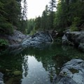 Flipping off one of the smaller cliffs at Cherry Flat.- California's 35 Best Swimming Holes