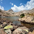 Blue Lake and Mount Toll (12,979 ft) in Indian Peaks Wilderness.- Wander Among Wilderness Areas