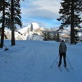 Skiing down the famous Glacier Point Road switchbacks with a full view of Half Dome.- Snowventure