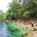 The stunning blue waters at Troy Spring State Park make for a perfect escape from the Florida heat.- East Coast State Parks that Will Blow Your Mind